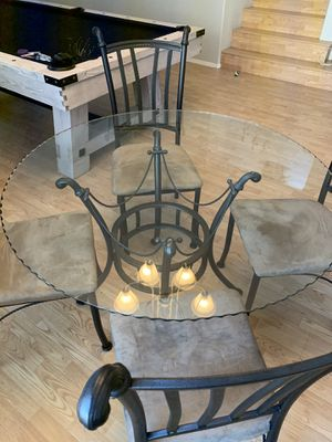 Round glass table with chairs for Sale in Phoenix, AZ