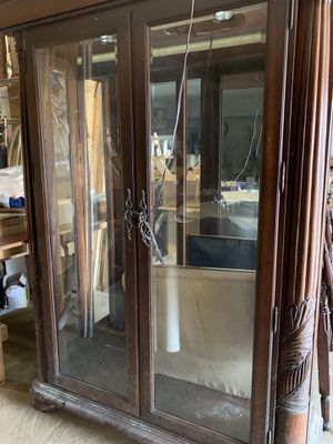 Large two door china cabinet must sell. Lighted with glass shelves..Paid $1200 only want $500. for Sale in Bacliff, TX