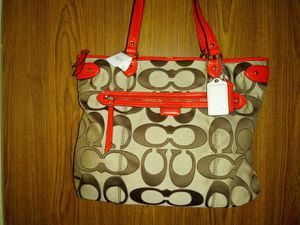 Coach purse orange and brown for Sale in New York, NY