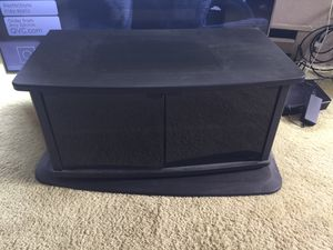 Swivel base tv stand, glass doors open to hold DVD player and tapes for Sale in Montesano, WA