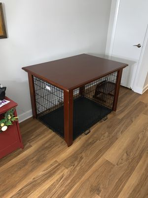 Brown table with dog kennel for Sale in Alexandria, VA