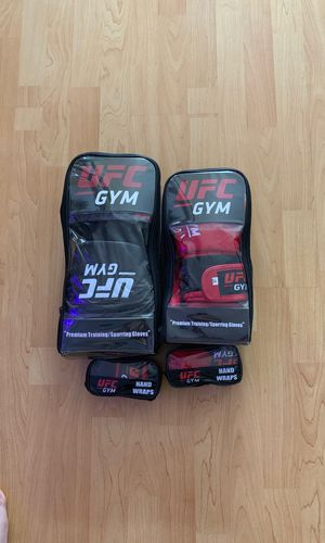 Barley used ufc gloves with hand wraps for Sale in Los Angeles, CA