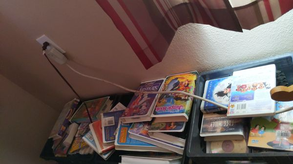 3 cases of Disney vhs and DVD