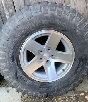 """5x4.5 16"""" Jeep Wrangler Rubicon wheel with tire for Sale in Port Orchard, WA"""