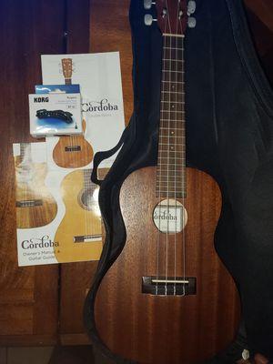 Cordoba ukulele model up100 w tuner for Sale in Tampa, FL