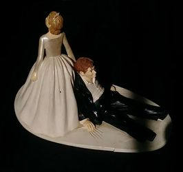 BRIDE dragging GROOM Porcelain Figurine for Sale in San Diego,  CA