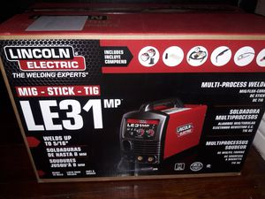 Lincoln Electric 140 Amp LE31MP Multi-Process Stick/MIG/TIG Welder with Magnum Pro 100L Gun, MIG and Flux-Cored Wire, Single Phase, 120V brand new for Sale in San Bernardino, CA
