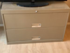 Well constructed 2-drawer lateral filing cabinet with hanging racks inside drawers for files. for Sale in Phoenix, AZ