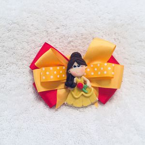 Exclusive handmade princess bows for girls with beautiful clay dolls for Sale in Katy, TX