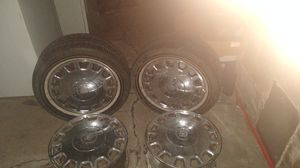 4 caddy rims. 2 P225/55R16 tires.they are used. for Sale in Rochester, NY
