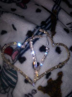 Silver diamond heart shaped earrings for Sale in Dallas, TX