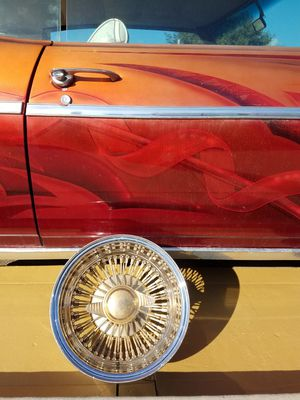 13x7 center gold 72 spoke wire ONE 13 inch Dayton 225A rim and dayton knockoff stamp 9223 stainless steel spokes for Sale in Dinuba, CA
