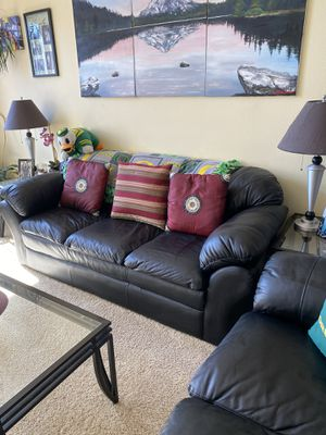 Ashley black leather sofa, loveseat, glass coffee table & two end tables for Sale in Washougal, WA
