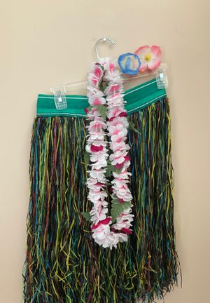Plastic hula skirt with flower lei and hair flowers for Sale in Glassboro, NJ