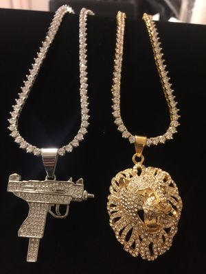Fully loaded lion charm and fully loaded rifle charm 18kt gold plated for Sale in Silver Spring, MD