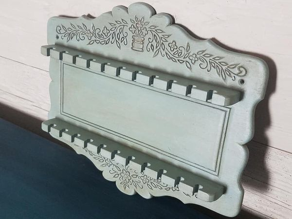 Vintage tea spoon rack which could be use as a jewelry holder has been painted in duck egg and aged with dark wax.