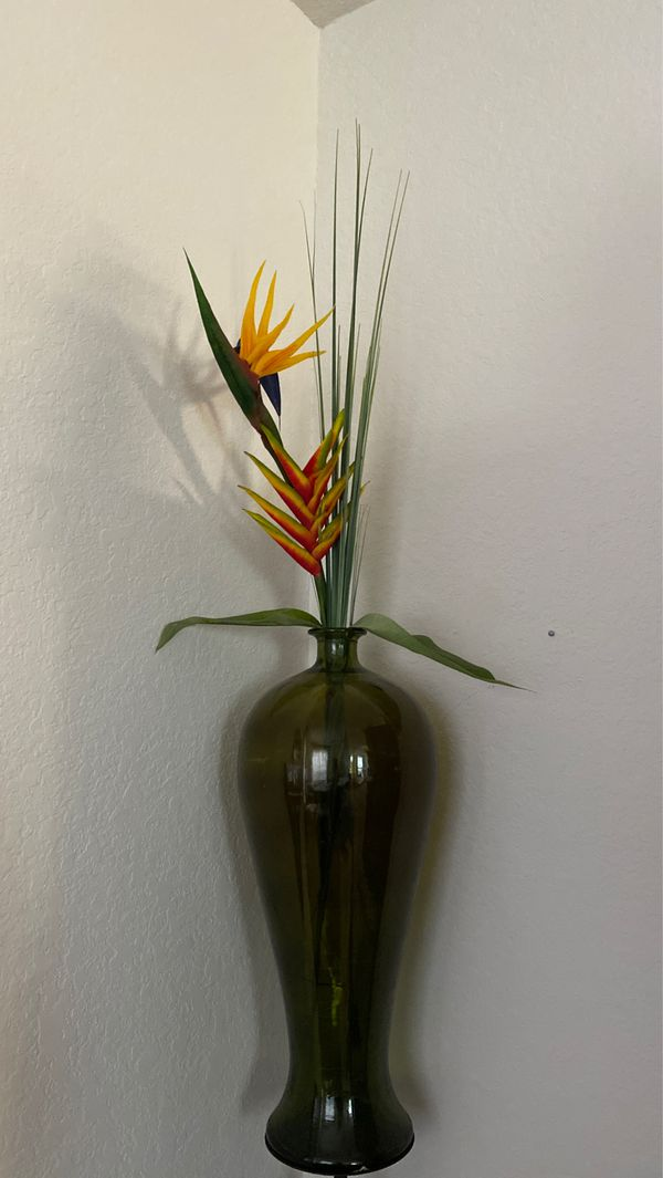 Glass vase with bird of paradise flower