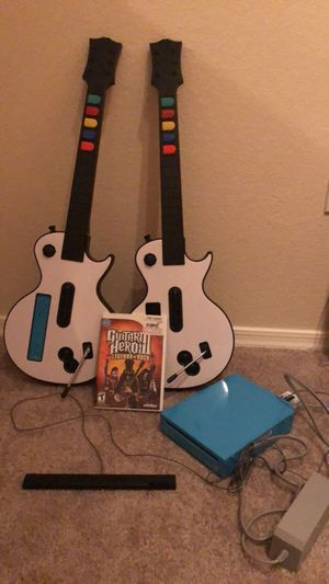 Wii Console, 1 controller, Guitar Hero Game, and Two Guitars for Sale in Tempe, AZ