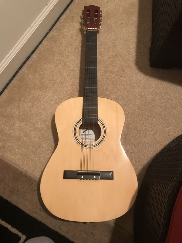 Acoustic guitar, good as new! Comes with case & box