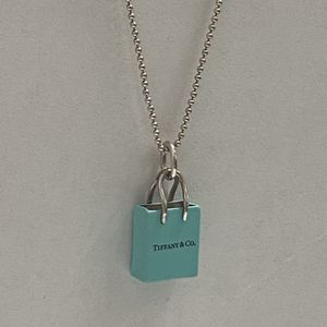 Tiffany & Co blue Enamel shopping bag pendant charm silver ball chain necklace for Sale in Miami, FL