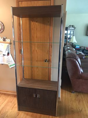 Two Glass shelves with lower cabinet for Sale in Brooklyn, OH