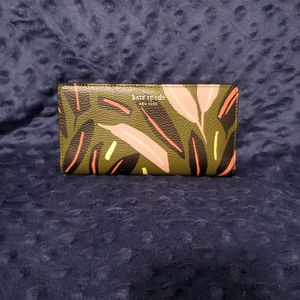 Authentic Kate Spade large slim bifold wallet. Eva Modern Feather. Green multi for Sale in Portland, OR