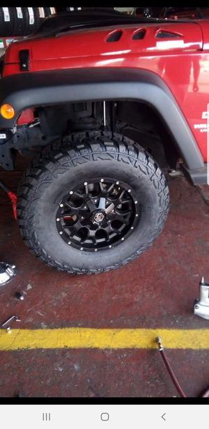 Jeep Wrangler rims 17x9 with 35x12.50 17 M/T for Sale in Phoenix, AZ