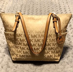 Michael Kors Iconic MK Jet Set Tote Bag paid $240 Great condition super cute bag. Zipper tote with MK logo hang tag lite brown monogram dark brown le for Sale in Washington, DC