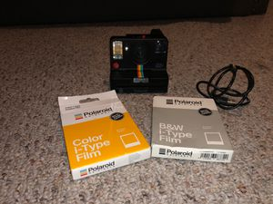polaroid one step with black and white and colored films. with charger. for Sale in Lake Worth, FL