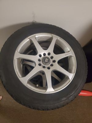 Less then 6 month old winter tires with 5 lug universal rims had them on Nissan altima for Sale in Hartford, CT