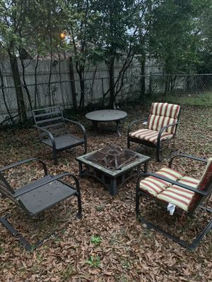 Fire pit set with 4 cover set for seating included for Sale in West Columbia, SC