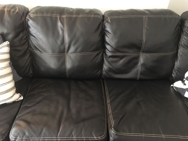 Black leather faux sectional couch + ottoman