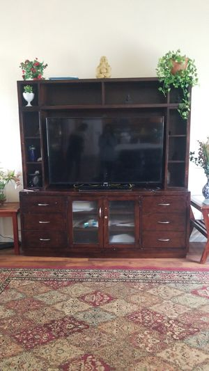 55 inch tv stand good condition. We are moving so it needs to go asap! for Sale in Aurora, CO