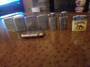 Zippo lighters and three camel lighter for Sale in Midland, PA