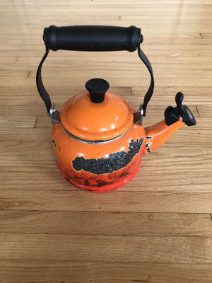 Le Creuset orange tea pot with some enamel cracked off for Sale in Los Angeles, CA