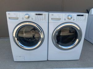 LG FRONT LOAD WASHER AND ELECTRIC DRYER SET WITH STEAM for Sale in Grand Prairie, TX