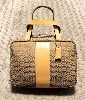 "Coach Travel Train Cosmetic case/bag paid $145 Like New! No signs of wear. Signature Jacquard Toiletry bag. Color Brown & Tan Measurements 11""L x 4""W for Sale in Washington, DC"