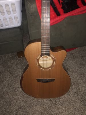 Washburn acoustic guitar with built in tuner and leather hard case for Sale in Delaware, OH