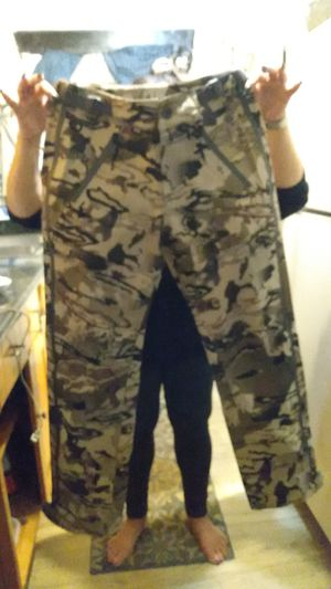 BRAND NEW UNDER ARMOUR -STORM PROOF CAMO PANTS for Sale in Tacoma, WA
