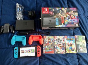 Nintendo Switch with Blue and Red Controllers and Mario Kart 8 Bundle 5 Games. Call or6465836089Text me. for Sale in Houston, TX