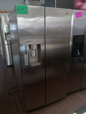 STAINLESS STEEL SIDE BY SIDE LG WITH ICE MAKER AND WATER for Sale in Murrieta, CA