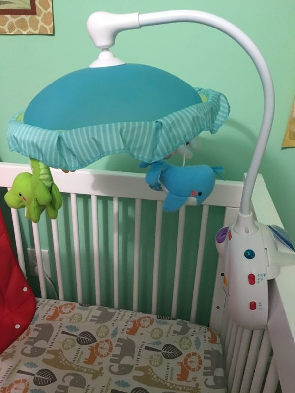 Crib mobile with music and lights - gently used!