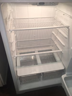 "GE Top freezer refrigerator 31.3"" - 20.8 cu ft - White for Sale in Norwalk, CA"