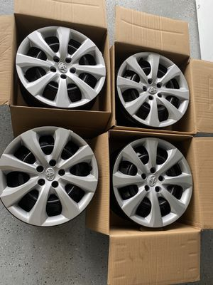 New Stock factory rims 16 and hubcaps for Sale in Palm Bay, FL