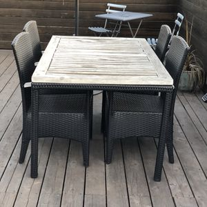 Outdoor black rattan wooden tabletop and 4 chairs for Sale in Los Angeles, CA