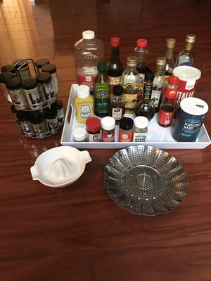 Kitchen goods: spice rack, veggie steamer, lemonade, white container with condiments for Sale in Alhambra, CA