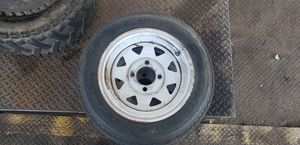 Two 4 lug trailer rims and tires Size 4.80 -12 for Sale in Phoenix, AZ