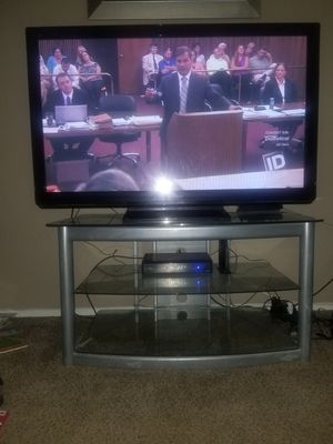 50 inch panasonic with glass tv stand... 3 glass shelves. for Sale in Florissant, MO