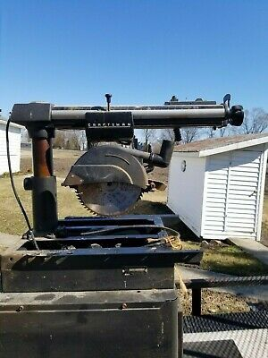Craftsman Radial Arm saw w/ Table and cabinet for Sale in Millcreek, UT