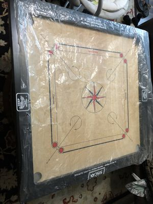 Brand new Carom game Board with carom coins for Sale in Gaithersburg, MD